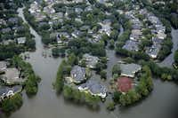 A flooded neighborhood off North Eldridge Parkway near the Addicks Reservoir in West Houston, Texas, was inundated with water, Wednesday, August 30, 2017.(Tom Fox/The Dallas Morning News)