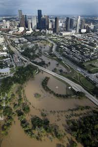 The swollen Buffalo Bayou is pictured in front of the Houston, Texas skyline, Wednesday, August 30, 2017. (Tom Fox/The Dallas Morning News)