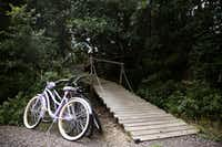 Bicycles are parked by the walkway leading to the Bare Creek Treehouse at Savannah's Meadow(Rose Baca/Staff Photographer)
