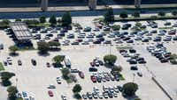 People wait in line to get gas at the Costco at Sam Rayburn Tollway and Interstate 35 in Lewisville on Thursday.(Vernon Bryant/Staff Photographer)