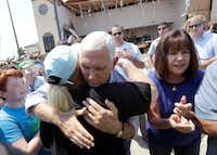 Vice President Mike Pence, center, with his wife Karen, right, shares a hug as he tries to encourage residents effected by Hurricane Harvey during a visit on Thursday in Rockport.(Eric Gay/AP)