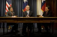 Texas Gov. Rick Perry, Attorney General Greg Abbott and Agriculture Commissioner Todd Staples at a news conference at the Capitol on Tuesday Feb. 16, 2010. (Jay Janner/Austin American-Statesman)