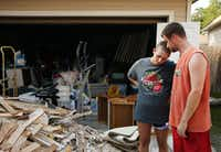 Josh and Sarah Dill were at home when they had to evacuate when flood waters entered their home with their two children, Brian, 4, and Rebekah, 2, and into an inflatable boat. When Josh tried to close the front door on the way out the door slammed on his hand and broke it. After finding a job in January 2017 after a stint of unemployment, the family found out the Sarah had breast cancer in February of 2017. Sarah has had a mastectomy and a chemotherapy treatment, and had to get a radiation treatment on the day recovery efforts were taking place in her house. Following flooding caused by Harvey they are gutting their home of damaged items and sheetrock.(Andy Jacobsohn/Staff Photographer)