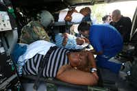 Baptist Hospital employees and Army flight crew prepare patients for take off after waiting to be evacuated on Army Black Hawks, because of citywide loss of water in Beaumont, Texas, August 31, 2017.(Rick Moon/Special Contributor)