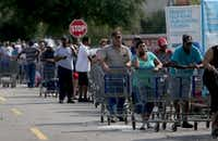 Residents wait hours in long lines at a Lowes, in Beaumont, Texas, August 31, 2017.(Rick Moon/Special Contributor)