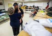 Joyce Brown, left, office manager of the Lumberton Central Fire Station, talks to Firefighter Kyle Parry, who retrieved the wedding dress of his fiancee, Stephanie Hoekstra, not pictured, of Chatham-Kent, Ontario, Canada, from his home, which is flooded as a result of Tropical Storm Harvey on Thursday, August 31, 2017 in Lumberton, Texas. Parry and Hoekstra are supposed to be married on September 10 in Galveston, TX. Parry's home is destroyed, but he was able to retrieve the dress.(Ashley Landis/Staff Photographer)