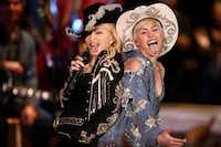 Madonna and Miley Cyrus perform on  MTV in  2014. (File Photo/The Associated Press)
