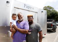 Dale Poullard, holding his 9-month-old granddaughter, Stormie Fontenot, and 17-year-old son Dustin Poullard brought their food trailer with them.(Vernon Bryant/Staff Photographer)