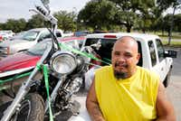 Leo Gamez, with his new motorcycle, is hoping to go home soon. (Vernon Bryant/Staff Photographer)