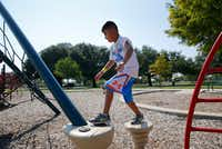 Victor Campos, 7, plays in the playground next to Samuell Grand Recreation Center in Dallas on Thursday.  (Vernon Bryant/Staff Photographer)