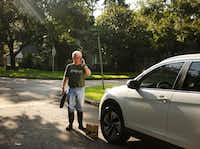 Jon Gjertsen, whose home sustained 4 to 5 inches of water damage, prepares supplies for his house while talking to his employer. He lives near Nottingham Elementary School in west Houston.(Andy Jacobsohn/Staff Photographer)