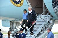 President Donald Trump and first lady Melania Trump arrive at Ellington Field in Houston Saturday.(Nicholas Kamm/Agence France-Presse)