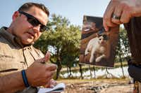 Texas DPS Trooper Mike Blackwell takes notes on a resident's pet and address before going out on a search boat into the Cinco Ranch Canyon Gate subdivision Sept. 2, 2017.(Smiley N. Pool/Staff Photographer)