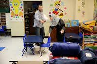 Samer Elsaadi (left) and his wife, Fawzia Adi Elsaadi, rearrange a classroom after staying there while sheltering at Masjid Sabireen in Sugar Land on Friday. The family stayed in the masjid for several nights before going to stay with Samer's brother. Masjid Sabireen were sheltering evacuees in their school and prayer halls following flooding caused by Harvey.(Andy Jacobsohn/Staff Photographer)
