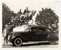 "A. Phimister Proctor, a New York sculptor who produced the equestrian statue of Robert E. Lee, is shown beside his new Lincoln-Zephyr which he has named ""Traveler"" after the Confederate General's horse. The sculptor has more equestrian statues in this country than any other noted artist. The Dallas statue was unveiled June 12, 1936 by President Franklin D. Roosevelt who also spoke at the Texas Centennial Exposition, at Fair Park, while in town that day.(DeGolyer Library/Southern Methodist University)"