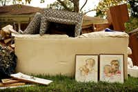 One family had to trash portraits and much of their furniture.(Andy Jacobsohn/Staff Photographer)