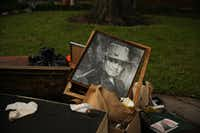 Residents had to trash framed photos of actors and reprints of famous paintings. One family trashed encyclopedias from the 1960s.(Andy Jacobsohn/Staff Photographer)