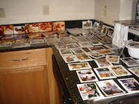 Photos that were saved from the Ferran/Cardona home in New Orleans lay out to dry after being cleaned. The water that flooded the house after Hurricane Katrina hit the city in August 2005 caused discoloration and erased the image from the edges of the photos.(Courtesy/The Ferran Family)