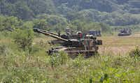 South Korean army soldiers take positions with their K-55 self-propelled howitzers during a military exercise in Paju, South Korea, near the border with North Korea, Monday, Sept. 4, 2017. North Korea said it set off a hydrogen bomb Sunday in its sixth nuclear test, which judging by the earthquake it set off appeared to be its most powerful explosion yet. (Ahn Young-joon/The Associated Press)