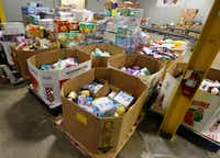 Chefs' Produce staff prepares donations at the company's Dallas warehouse on Sept. 1.(Ron Baselice/Staff Photographer)