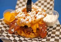 <p>Funnel cake bacon queso burger</p>(Jae S. Lee/Staff Photographer)