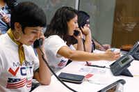 Linda Rivas, from left, Liz Magallanes, 23, center, DFW Coordinator for Mi Familia Vota, and Maria de Jesus Garza, answer phone calls about the DACA program at Univision TV studios in Dallas on Monday. President Trump is expected to announce Tuesday that the DACA program will end in 6 months.(David Woo/Staff Photographer)