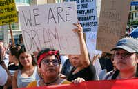 Supporters of the Deferred Action for Childhood Arrivals, or DACA chant slogans and hold signs while joining a Labor Day rally in downtown Los Angeles on Monday. (Richard Vogel/The Associated Press)