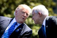 Attorney General Jeff Sessions (right) was one of several advisers who pushed President Donald Trump to end the program.(Doug Mills/The New York Times)