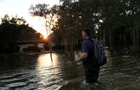 Samir Novruzov walks through a flooded street Monday in Katy, Texas. Over a week after Hurricane Harvey hit Southern Texas, residents are beginning the long process of recovering from the storm. (Justin Sullivan/Getty Images)