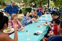 Megan Raleigh, 37, Stephanie Wakeem, 41, and Laura Daulton, 36, mingle with other neighbors while having dinner during Daulton's turquoise table neighborhood gathering.(Ben Torres/Special Contributor)