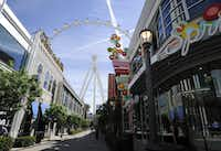 The Las Vegas High Roller towers over the shops at The LINQ.(David Becker/The Associated Press)