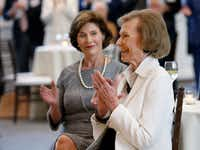 Philanthropist Ruth Altshuler reacts after being honored at a reception next to Laura Bush at Perot Companies in Dallas on Tuesday, Sept. 5, 2017. (Rose Baca/The Dallas Morning News)(Rose Baca/Staff Photographer)