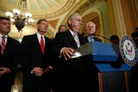Senate Majority Leader Mitch McConnell (at lectern) of Kentucky, accompanied by (from left) Sen. Cory Gardner of Colorado, Sen. John Barrasso of Wyoming, Sen. John Thune of South Dakota and Sen. John Cornyn of Texas speaks with reporters after the weekly Senate Republican policy luncheon at the U.S. Capitol.(Aaron P. Bernstein/Getty Images)