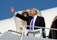 President Donald Trump waves during his arrival at Bismark Municipal Airport on Wednesday. The president traveled to North Dakota to promote his tax overhaul plan. (Pablo Martinez Monsivais/The Associated Press)