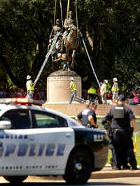 Crews from Howell Crane and Rigging, Inc tried to remove the Robert E. Lee statue with a crane from Robert E. Lee Park in Dallas on Wednesday. The removal was halted though by a temporary restraining order from U.S. District Judge Sidney A. Fitzwater.(Tom Fox/Staff Photographer)