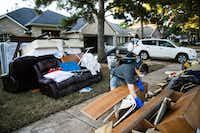 Chumming Xu looks through his flood damaged belongings in the aftermath of Hurricane Harvey on Thursday, Sept. 7, 2017, at the Canyon Gate community in Katy, Texas. (AP Photo/Matt Rourke)(Matt Rourke/AP)