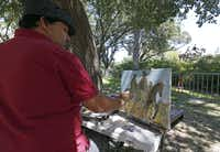 "Artist Jerrel Sustaita works on his painting of the Robert E. Lee statue at Robert E. Lee Park in Dallas, Thursday, Sept. 7, 2017. He said, ""I might not be able to do it tomorrow."" (Jae S. Lee/Staff Photographer)"