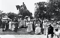 Dressed for a celebratory occasion, members of a crowd mill about the newly unveiled statue of Robert E. Lee after President Franklin D. Roosevelt dedicated it at Lee Park in Dallas, Texas, on June 12, 1936.(Dallas History & Archives Division/Dallas Public Library)