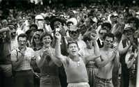 Gay supporters applaud a speaker in Lee Park after the Pride Parade in June 1983.(Carlos Osorio/Staff Photographer)