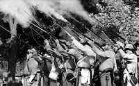 Re-enactors fire their guns to  honor and salute Confederate heroes at the third annual Confederate Heritage Day at Lee Park on May 20, 1995.(David Woo/Staff photographer)