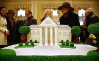 To celebrate the 10th anniversary of the rededication of Arlington Hall, the Lee Park & Arlington Hall Conservancy invited the public to a ceremonial groundbreaking and community open house. An anniversary cake, punch and coffee were served Jan. 13, 2013. Judy Pittman, center with hat, and her husband Bill donated $300,000 toward the park space along Turtle Creek Boulevard.(Tom Fox/Staff Photographer)