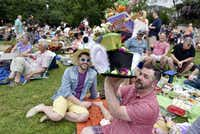A.J. De la Osa of Dallas prepares to wear his Easter hat while sitting with Brandon King, left, during Easter in Lee Park on April 16, 2017.(Ben Torres/Special Contributor)