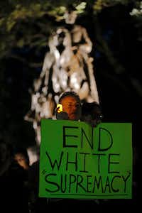 Gary Stuard attends a candlelight vigil held by the Democratic Socialists of America, North Texas group, to remember Heather Heyer, at Lee Park in Dallas on Aug. 23, 2017. Heyer was killed by James Alex Fields Jr. when he ran his car into a group of protesters in Charlottesville, Va.(Brandon Wade/Special Contributor)