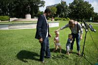 The Rev. Dr. Jeff Hood greets his children, Jeff Hood Jr. and Quinley Mandela Hood, as their father and minister Dominique Alexander speak to reporters about the Confederate statue removal efforts Aug. 18, 2017. Hood and Alexander were calling into question Dallas Mayor Mike Rawlings calling for a task force to look into the issue of removing public Confederate monuments.(Andy Jacobsohn/Staff Photographer)