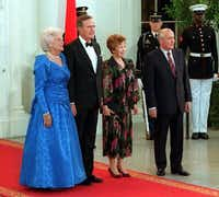 President George Bush and first lady Barbara Bush welcomed Soviet President Mikhail Gorbachev and his wife, Raisa, for a state dinner at the White House in May 1990. (File Photo/The Associated Press)