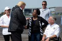 President Donald Trump talks with Rep. Sheila Jackson Lee, D-Texas, and Texas Gov. Greg Abbott before boarding Air Force One at Ellington Field after meeting people affected by Hurricane Harvey during a visit to Houston on Sept. 2.(Susan Walsh/The Associated Press)