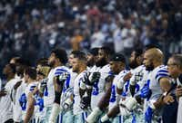 """<p><span style=""""font-size: 1em; background-color: transparent;"""">The Dallas Cowboys stand during the national anthem before their opener against the New York Giants on Sunday, September 10, 2017 at AT&T Stadium in Arlington, Texas.</span></p>(The Dallas Morning News/Ashley Landis)"""