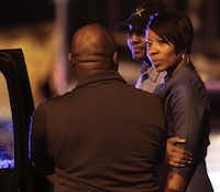 Dallas Police Chief Renee Hall talks to Dallas City Manager T. C. Broadnax, left, at the accident site. (Irwin Thompson/Staff Photographer)