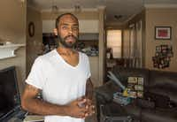 <p>Robin Bobo unpacks in an apartment after living in limbo for weeks because he could not find an acceptable apartment that would take his Section 8 housing voucher.</p>(Rex C Curry/Special Contributor)