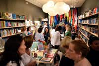 Susan Graass (center) speaks with Kim Cox (left) and Benaye Rogers during Monday's grand opening of Interabang Books in Dallas.(Ben Torres/Special Contributor)